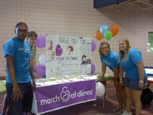 One of Augustana's newest organizations, Augie March of Dimes (MOD), advertises at the student activities fair for first year students in August.