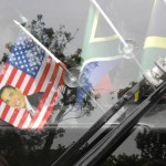 Flags on our tour bus--note the American flag with Obama on it.  They LOVE Obama here.