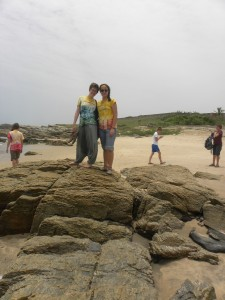 Maggie and I on the rocks on the shore.