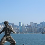 Bruce Lee Statue with the HK skyline